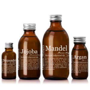 vegetabiliska ekologiska oljor i glasflaskor